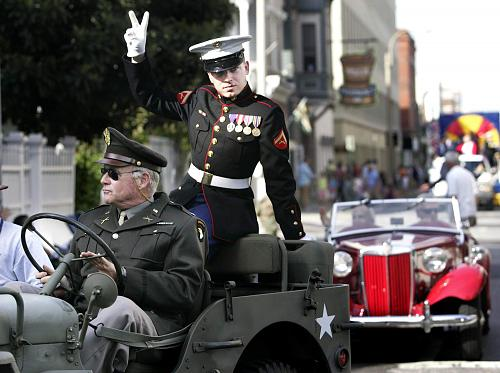 Former Marine Lance Cpl. Nick Riccio of Charleston serves as grand marshal of the 2005 Veterans Day Parade as it makes its way down King Street. Riccio died this week, 10 years after surviving a massive brain injury while serving in Iraq. File/Grace Beahm/staff