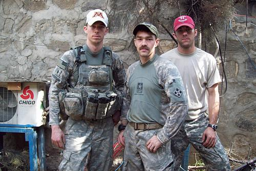 Left to right: Then 1st Lt. Andrew Bundermann, then Staff Sgt. Clinton L. Romesha and then Sgt. Brad Larson pose during their deployment to Afghanistan in 2009 with Bravo Troop, 3rd Squadron, 61st Cavalry Regiment, 4th Brigade Combat Team, 4th Infantry Division. They fought a brutal, 12-hour battle against some 300 insurgents who attempted to overrun their small remote base, Combat Outpost Keating, Oct. 3, 2009. For their heroism in repelling the attack, Bundermann and Larson were awarded Silver Stars and Romesha will receive the Medal of Honor in a Feb. 11, 2013, White House ceremony. (Photo courtesy of 1st Lt. Brad Larson)