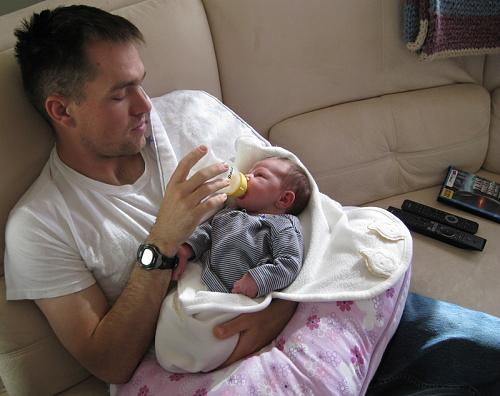 Former Staff Sgt. Clinton L. Romesha feeds his second daughter, Gwen. He deployed to Afghanistan in the spring of 2009, about five weeks after she was born. Just a few months later, he defended Combat Outpost Keating against about 300 enemy fighters, actions that would earn him the Medal of Honor. (Photo courtesy of Clinton L. Romesha)