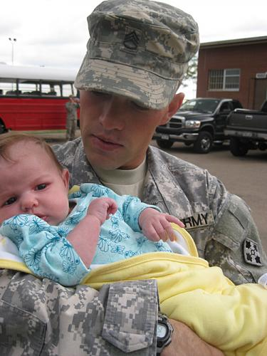 Former Staff Sgt. Clinton L. Romesha with his son, Colin, who was born after Romesha returned from his 2009 deployment to Afghanistan, where his actions helped save Combat Outpost Keating. Those actions will be recognized with the Medal of Honor in a Feb. 11, 2013, White House ceremony. He misses the Army, he said, but doesn't miss having to leave family. (Photo courtesy of Clinton L. Romesha)