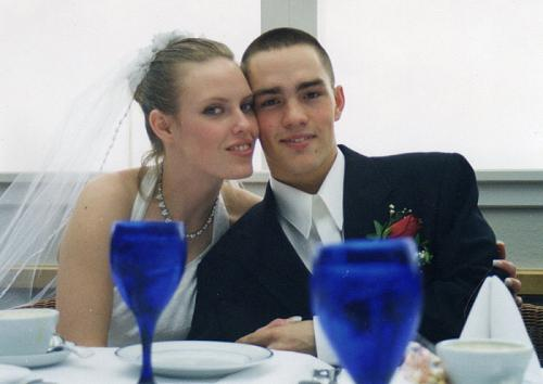 Tammy and Clinton L. Romesha at their wedding in February 2000. Tammy was actually still in high school and Romesha had just graduated from Basic Training. He calls her his moral compass, and said that without her strength, support and independence, he wouldn't have been able to concentrate on the battlefield enough to help save Combat Outpost Keating from being overrun by about 300 insurgents on Oct. 3, 2009. In recognition of his valor, Romesha will receive the Medal of Honor in a Feb. 11, 2013, White House ceremony. (Photo courtesy of Clinton L. Romesha)