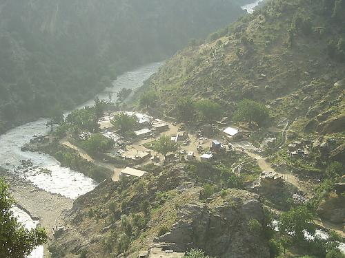 Pictured is a view of Combat Outpost Keating on the Pakistan-Afghanistan border in a remote pocket of Afghanistan, known as Nuristan. According to soldiers who called the outpost home, being at Keating was like being in a fishbowl or fighting from the bottom of a paper cup. It was there, surrounded by mountains and insurgents, that former Staff Sgt. Clinton L. Romesha and his fellow soldiers fought back the enemy in a fierce 12-hour battle, Oct. 3, 2009. (Photo courtesy of 1st Lt. Brad Larson)