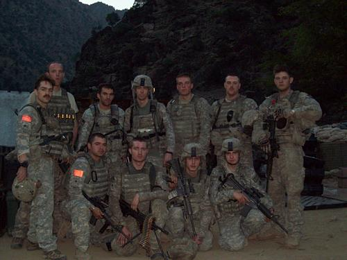 Soldiers of Bravo Troop, 3rd Squadron, 61st Cavalry Regiment, 4th Brigade Combat Team, 4th Infantry Division pause for a photo after a mission in Afghanistan in 2009. Standing, Left to right: Medal of Honor recipient then Staff Sgt. Clinton L. Romesha, then Spc. Thomas Rasmussen, then Sgt. Brad Larson, then 1st Lt. Andrew Bundermann, then Pfc. Christopher Jones, Spc. Kugler and Spc. Knight. Kneeling, left to right: Then Sgt. Armando Avalos, Jr., Spc. Zach Koppes, Spc. Gregory, Pfc. Davidson. (Photo courtesy of 1st Lt. Brad Larson)